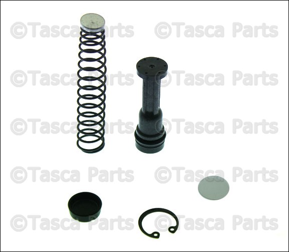 NEW OEM CLUTCH MASTER CYLINDER INNER PARTS KIT MAZDA W